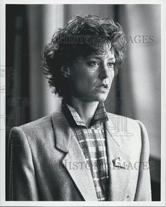 Press Photo An actress in a business suit in a film