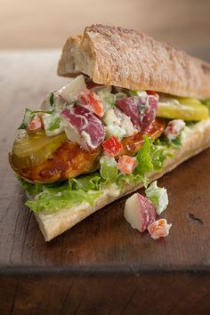It's a BBQ leftovers sandwich! Make it by layering Hellmann's Mayonnaise, barbeque chicken, pickles, lettuce and potato salad on a fresh baguette.