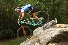 Catharine Pendrel of Canada races during the Women's Cross-Country Mountain Bike Race on Day 15 of the Rio 2016 Olympic Games at the Mountain Bike Centre on August 20, 2016 in Rio de Janeiro, Brazil.