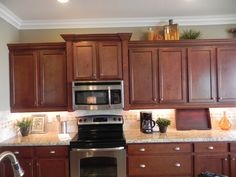 different height kitchen cabinets hang an the range microwave without an overhead 14721