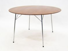 Model 3600 dining table by Arne Jacobsen for Fritz Hansen | From a unique collection of antique and modern dining room tables at https://www.1stdibs.com/furniture/tables/dining-room-tables/