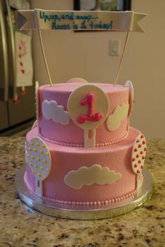 A hot air balloon first birthday cake (inspired by Confectioneiress)
