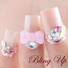 Japanese Nail Art Light Pink Nail Tip with Swarovski Rhinestones and 3d Ribbon. $49.99, via Etsy.