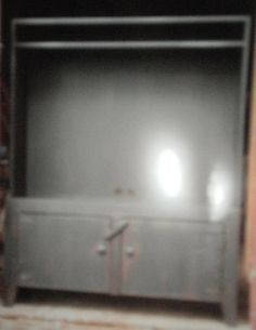 Black tv cabinet, for flat screen tv with storage in bottom from primitivepassions-onlinefurniture.com