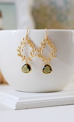 https://www.etsy.com/shop/LeChaim Gold Laurel Wreath Earrings. Dark Olive Glass Teardrop Matte Gold Laurel Wreath Earrings.by LeChaim