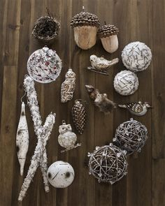 Infuse all the wonderment of an enchanting winter forest in its set of 35 handcrafted Woodland Christmas Ornaments.