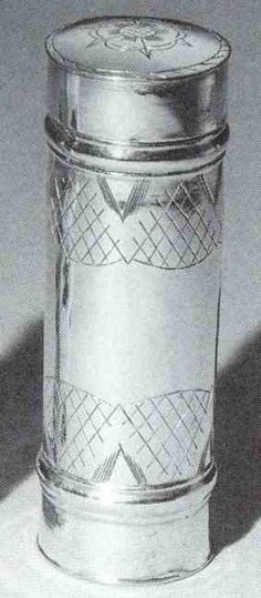 Cylindrical silver Nutmeg grater lightly engraved with two bands of foliage