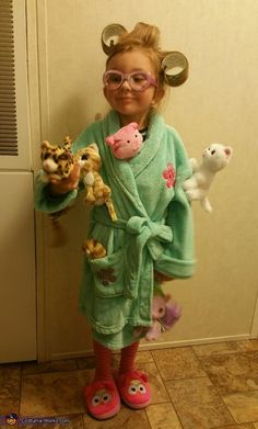 Stephanie: My 4 year old daughter Ava Grace dressed as the Crazy Cat Lady. She is an avid cat lover! We used a bathrobe and slippers we already had. We attached...