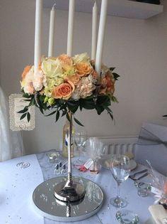 Peach and ivory candelabra wedding centrepiece