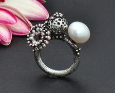Pod Genesis Ring  Sterling silver, cultured pearl, seed pearls, silk; hand fabricated, domed, pierced, soldered, granulation, liver of sulfur patina, hand finished, hand embroidered    Sophia Georgiopoulou