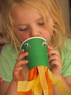 FAIRY TALE~Create your own fire-breathing dragon- what a fun craft for kids and all you need is a green cup, googly eyes, and some fire colored streamers