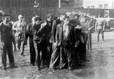 German soldiers splashing water on Jews before murdering them.