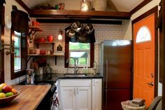 Gourmet kitchen with granite counters - POT RACK WOULD DEFINATELY SAVE SPACE Craftsman by Tiny Heirloom