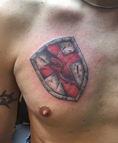 Shield of Faith tattoo, cover up, armor, cross.  Battle worn.