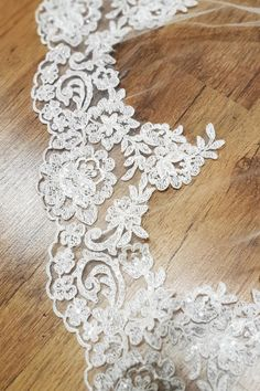 Stunning corded and beaded lace trim that can be added to any of our Irish made Bridal veils, made in our studio in Dublin. Available in white and Ivory.