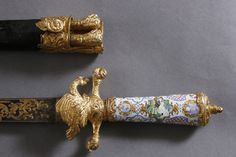 HUNTING KNIFE, German circa 1750, enamel grip with hunting scences, fire gilded metal