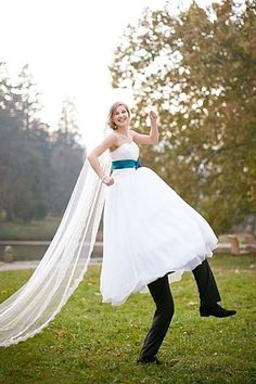A super-tall bride with slacks under her gown, or a bride on her groom's shoulders? You be the judge.