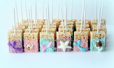 Elegant & delicious Mermaid Tails & Seashells topped Chocolate dipped Rice Krispie Treats in blue, pink & purple! Great for a Mermaid themed