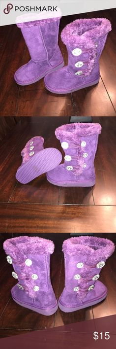 toddler boots never worn tag still on the bottom, beautiful royal purple with stone down the side. furry rim down the side super comfy! Shoes Boots