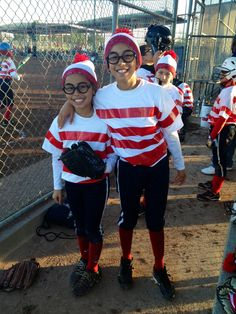 Softball team Halloween costume- Where's Waldo.  Duct taped plain white T's, added pom-poms to white beanies, and painted numbers on the backs of shirts - lots of work, but kept costs down.