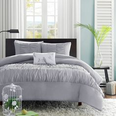 The Delia Duvet Cover Set creates an opulent look for your bedroom to update your current d�cor. The ruched fabric on the comforter and sham gives the appearance of scalloped edges and ruffles covering the bed.