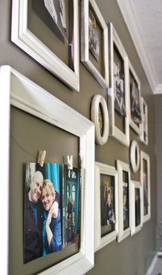 """My photo wall :)  Made from very inexpensive frames (found at the thrift store) which I spray painted.  Super easy!  I also used 3M Command Strips - they worked brilliantly for a project like this!"""