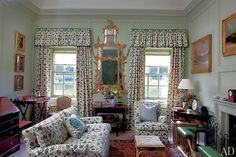 A Christopher Moore printed linen, based on an 18th-century document, is used in this south-facing sitting room, which was decorated for the use of the Prince of Wales; the gilt-wood pier glass was made by Mathie in 1759, and the walls are painted with Farrow & Ball's Vert de Terre.