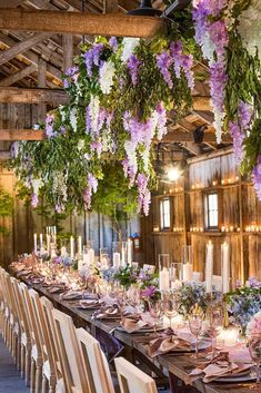 Wedding Reception wedding decor 2019 romantic barn candles and lilac hanging flowers whitelilacinc - Wedding experts predict that trends in wedding decor 2019 will be hanging floral and orange blooms. Look through our gallery to find more! Wedding Table Centerpieces, Wedding Flower Arrangements, Centerpiece Ideas, Hanging Flower Arrangements, Floral Arrangements, Wisteria Wedding, Arte Floral, Wedding Trends, Wedding Ideas
