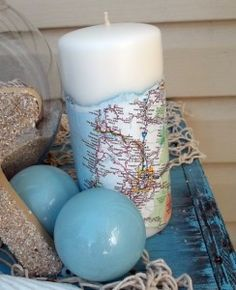 Super fast and easy map candles. Simply tear or burn a strip of map long enough to wrap around the base of the candle and mod podge it onto the candle. I make these for wedding/bridal showers (map candle of the couples honeymoon destination) a fun and inexpensive gift!