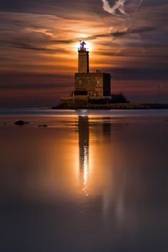 """The moon dawns over the lighthouse of Olbia - Sardinia"" Italy Photographer: Fabio Serra"
