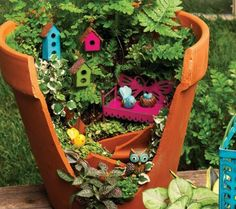 Gypsy Garden done by Genevieve Gail with broken clay pot !