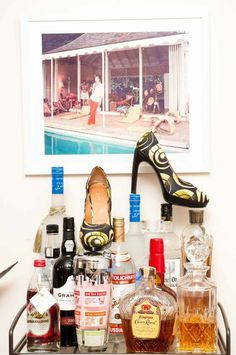 Slim Aarons photograph and bar cart in the apartment of Joanna Hillman via The Coveteur.