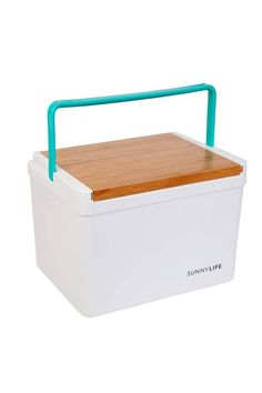 "A slide top made of bamboo serves as a flat table surface—or can be flipped to reveal a cutting board and two recessed drink holders—on a 13-liter picnic cooler with a cheery, color-pop contrast handle.    -14.17"" x 10.83"" x 10.24"" -4 lbs. -Holds 13 liters -Slide-open top -Polypropylene/plastic/bamboo    Sunnylife Cooler Box by SunnyLife. Home & Gifts - Home Decor - Outdoor Florida"