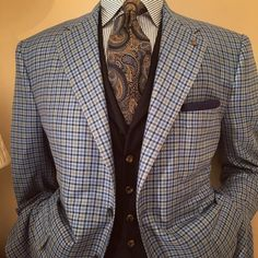 Check jacket, here in a featherweight cashmere and silk fabric woven in Italy by Loro Piana. Paired with wool and silk waistcoat and silk jacquard tie