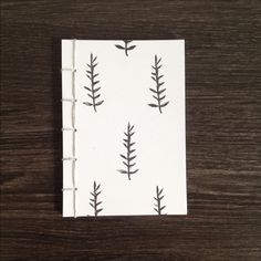 completely handmade small journal printed on the cover with one of my botanical patterns using block printing and stab bound together with light grey linen thread. approx. size 10.5x15 cm (4.1x...