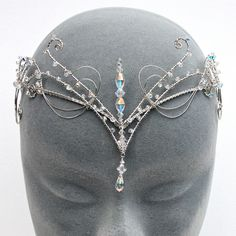 This circlet was inspired by twisted woodland branches and medieval design. It's made from silver plated wire, covered with genuine swarovski crystals and fastens at the back with a long silver chain