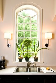 classic kitchen sink w sconces - different!
