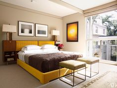 A pair of Hiroshi Sugimoto photographs surmount the master suite's original walnut bed by George Nelson for Herman Miller, now reupholstered in a Gretchen Bellinger mohair; the 1970s Milo Baughman stools are covered in a Fortuny cotton, and the photograph on the side wall is by Adam Fuss.