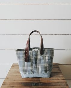 A Well Worn Story | tote bag made from a reclaimed plaid shirt, denim jeans, and an upcycled leather belt