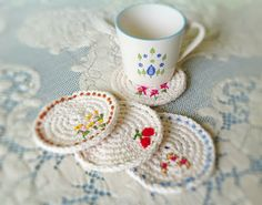 Crochet coasters  -  This is a super simple pattern and perfect for a crochet beginner.   You can make them personal by embroidering your own design. Free crochet pattern spring coasters