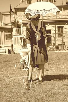 A parasol and a croquet mallet...perfect combination