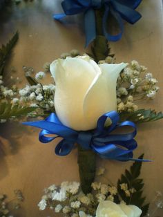 white rose boutonniere with blue ribbon White Rose Boutonniere, Prom Corsage And Boutonniere, White Rose Bouquet, Corsage Wedding, Wedding Bouquets, Wedding Boutonniere, Royal Blue Bouquet, Corsages, White Roses