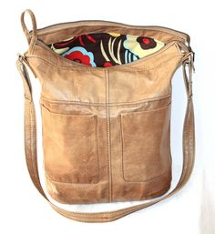A bag made of repurposed leather from a jacket