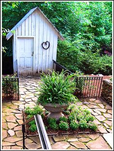Looks like the outhouse my granny had on her farm. What fun it would be to recreate that for our kitchen garden plot.