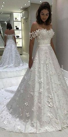 This is a sleeveless satin wedding dress with appliques. Silhouette:A Line Neckline:Off the Shoulder Fabric:Satin Embellishment:Appliques Sleeve Length:Sleeveless Back Details: Zipper Up Bohemian Wedding Dresses, Modest Wedding Dresses, Bridal Dresses, Lace Wedding, Floral Wedding, Floral Lace, Wedding White, Party Wedding, Summer Wedding