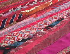 A vintage tie floor cloth.. love the big wide hand-stitching... how about in a fabulous bright colored silk or yarn! ♥