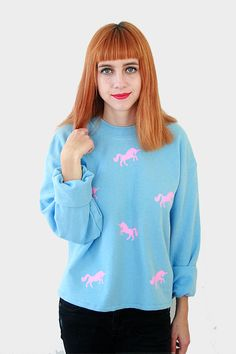This gorgeous Oversized, Boxy Unicorn Sweater from our Party range is perfect for chilly days in Autumn. The super cute unicorns are in a pastel pink transfer placed on the front of a baby blue raglan sleeve sweatshirt. The Jumper itself is super soft and oversized for a comfortable and relaxed fit in a cropped boxy shape. Very warm and perfect for the AW16 season teamed up with boyfriend jeans and boots.  80% Cotton, 20% Polyester.  Available in sizes S/M and M/L  S/M – 48″ ch...