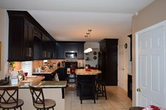 Kitchen remodel, built-in bench, different shaped island, dark cabinets, bar seating
