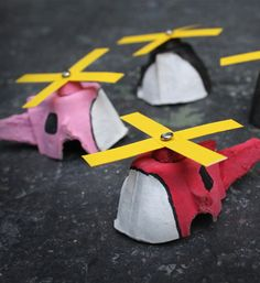 Egg Carton Mini Helicopter Craft - Clearly, I'll need to make a string of these for boy's flight school graduation...