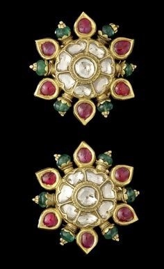 A pair of gem-set Earrings India, 20th Century of star form, set with alternating drop-shaped rubies and emerald beads in gold around a diamond floral centre, verso decorated with polychrome floral enamelled decoration on a cream ground with two small suspension loops, fitted with screw and clip